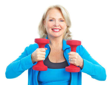 Gym & Fitness. Smiling elderly woman working out. Isolated over white background  photo