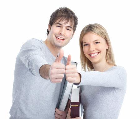若い笑顔生徒に本。白い背景の上 写真素材