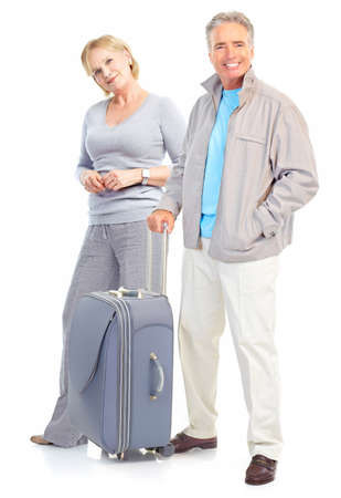 Senior couple travelers with bags. Isolated over white background  photo
