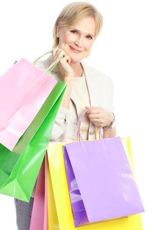 Shopping happy  elderly woman. Isolated over white background  photo