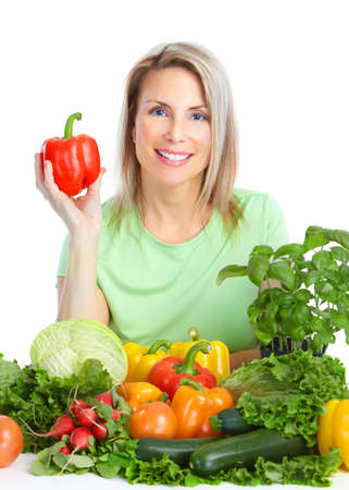 Young smiling woman  with fruits and vegetables. Over white background Stock Photo - 8736159