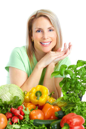 fruit salads: Young smiling woman  with fruits and vegetables. Over white background