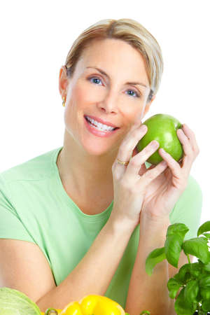 Young smiling woman  with fruits and vegetables. Over white background Stock Photo - 8736160