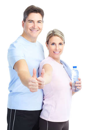 fitness couple: Fitness and gym. Smiling young  strong man and woman. Isolated over white background