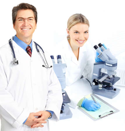 Science team working with microscopes in a laboratory  photo