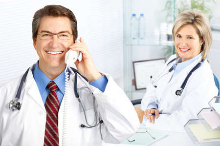 man with phone: Medical doctors working in the office