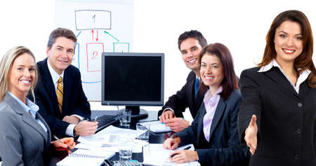 Smiling business people team working in the office photo