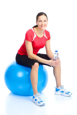 exercitation: Gym & Fitness. Smiling young  woman working out. Isolated over white background  Stock Photo