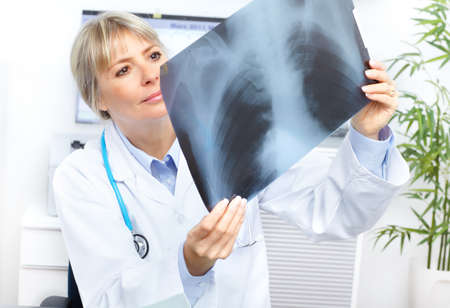 radiology: Medical doctor looking at a x-ray image in the office