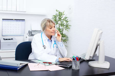 reception office: Medical doctor woman in the office  Stock Photo
