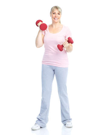 Gym & Fitness. Smiling elderly woman working out. Isolated over white background Stock Photo - 8736403