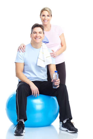 Gym & Fitness. Smiling mature couple working out. Isolated over white background