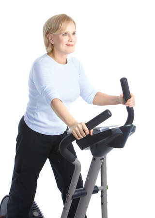 Gym & Fitness. Smiling elderly woman working out. Isolated over white background Stock Photo - 8738147