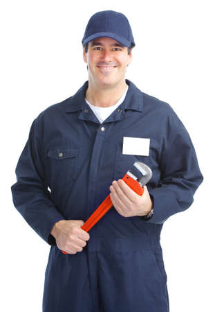 Mature handsome plumber worker with adjustable wrench. Isolated over white background  photo