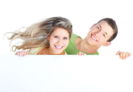 Young happy couple holding a white plackard photo
