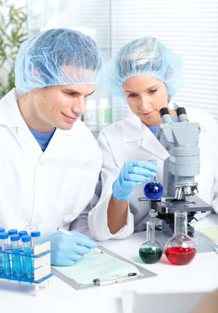 Science team working with microscopes at  laboratory  photo