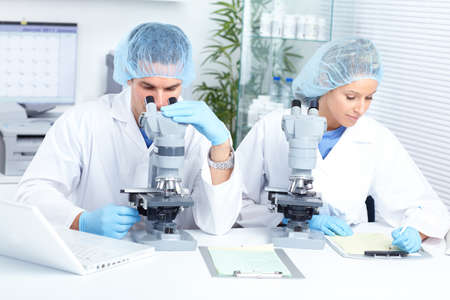 Science team working with microscopes at  laboratory Stock Photo - 8738270