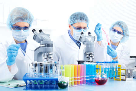 observation: Science team working with microscopes at  laboratory  Stock Photo