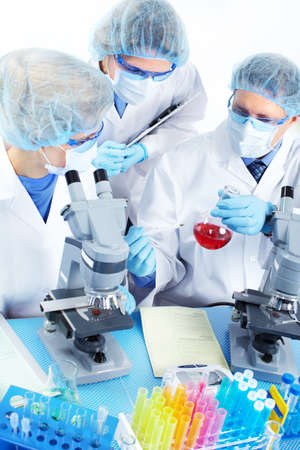Science team working with microscopes at  laboratory Stock Photo - 8738310