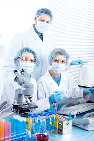 Science team working with microscopes at  laboratory Stock Photo - 8738271