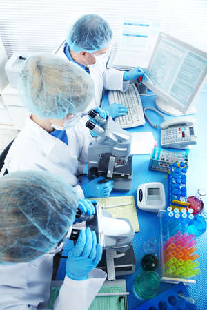 Science team working with microscopes at  laboratory Stock Photo - 8738326