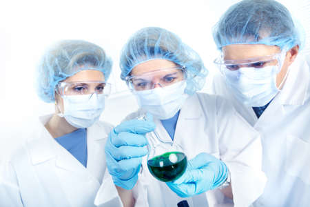Science team working with test tubes at  laboratory Stock Photo - 8738179