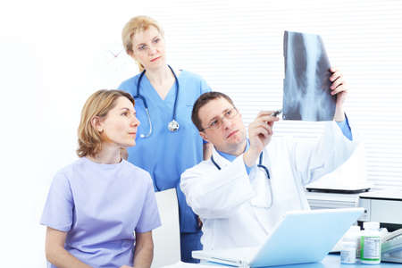Medical doctors and a woman patient.   photo