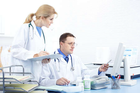 practise: Medical doctors working in the office