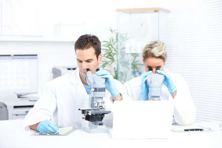 scientific: Science team working with microscopes in a laboratory