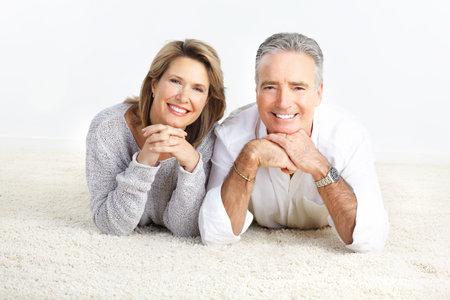 Happy elderly seniors couple at home photo