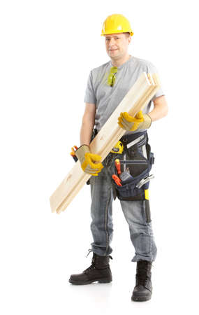 Handsome contractor with wood planks. Isolated over white background  photo