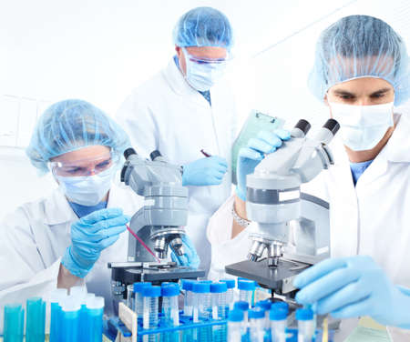 science lab: Science team working with microscopes at  laboratory  Stock Photo
