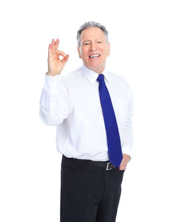 Handsome mature  businessman. Isolated over white background  photo