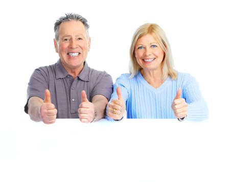 happy seniors couple holding a white placard Stock Photo - 8863676