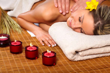 salon and spa: Beautiful young woman getting a massage
