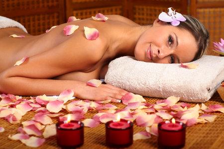 Beautiful young woman getting a massage  photo