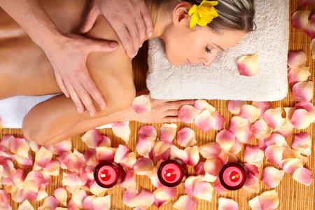 Beautiful young woman getting a massage Stock Photo - 8863832
