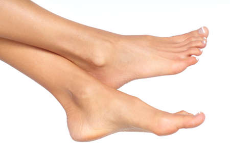 woman foot: Female feet. Isolated over white background
