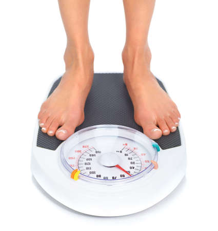 weight scale: Woman and scales. Over white background