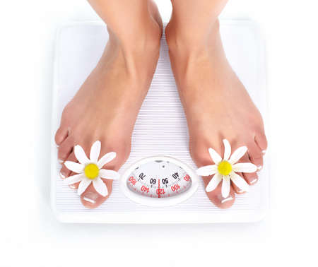 Woman and scales. Over white background  photo