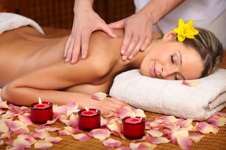healthy body: Beautiful young woman getting a massage