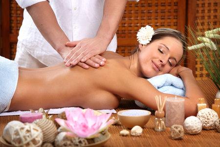 Beautiful young woman getting a massage Stock Photo - 8863801