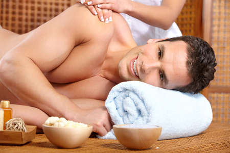 back rub: young handsome man getting a massage