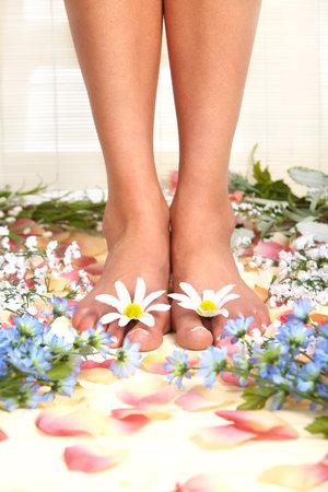 Female feet and flowers