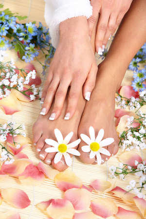 Female feet massage and flowers  photo