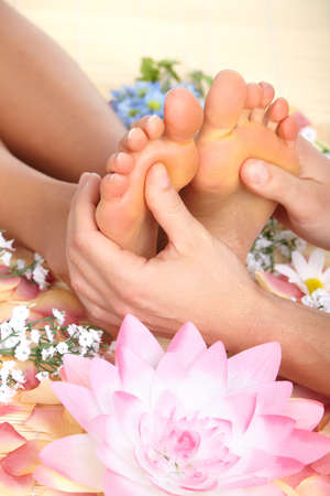 Female feet massage and flowers Stock Photo - 8863780
