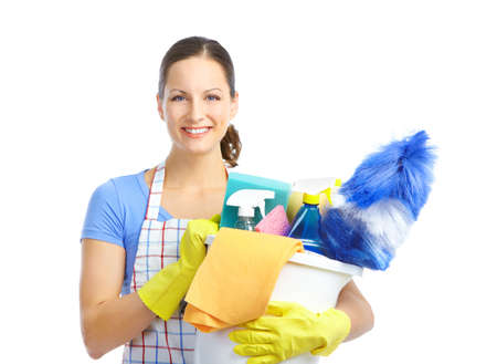 Young smiling housewife cleaner. Over white background  photo