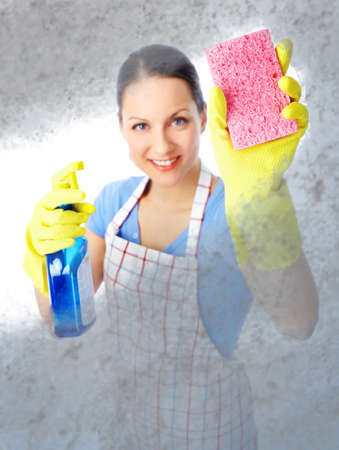 Young smiling housewife cleaner. Over white background Stock Photo - 8863697