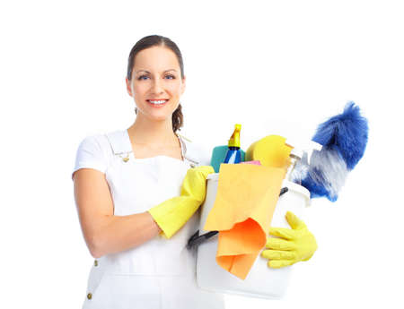 Young smiling housewife cleaner. Over white background Imagens