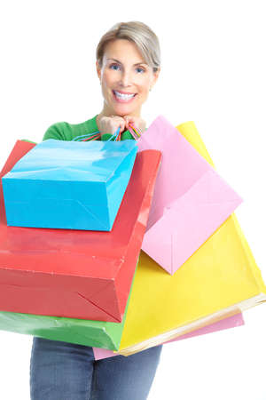 Shopping happy  woman. Isolated over white background  photo